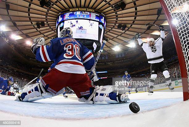 Dwight King of the Los Angeles Kings celebrates a goal on Henrik Lundqvist of the New York Rangers by Jeff Carter of the Los Angeles Kings during the...