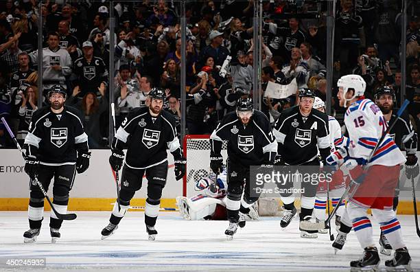 Dwight King of the Los Angeles Kings celebrates his goal against the New York Rangers with teammates during the third period of Game Two of the 2014...