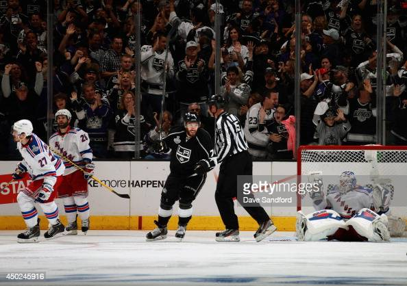 Dwight King of the Los Angeles Kings celebrates his goal as goaltender Henrik Lundqvist of the New York Rangers reacts during the third period of...