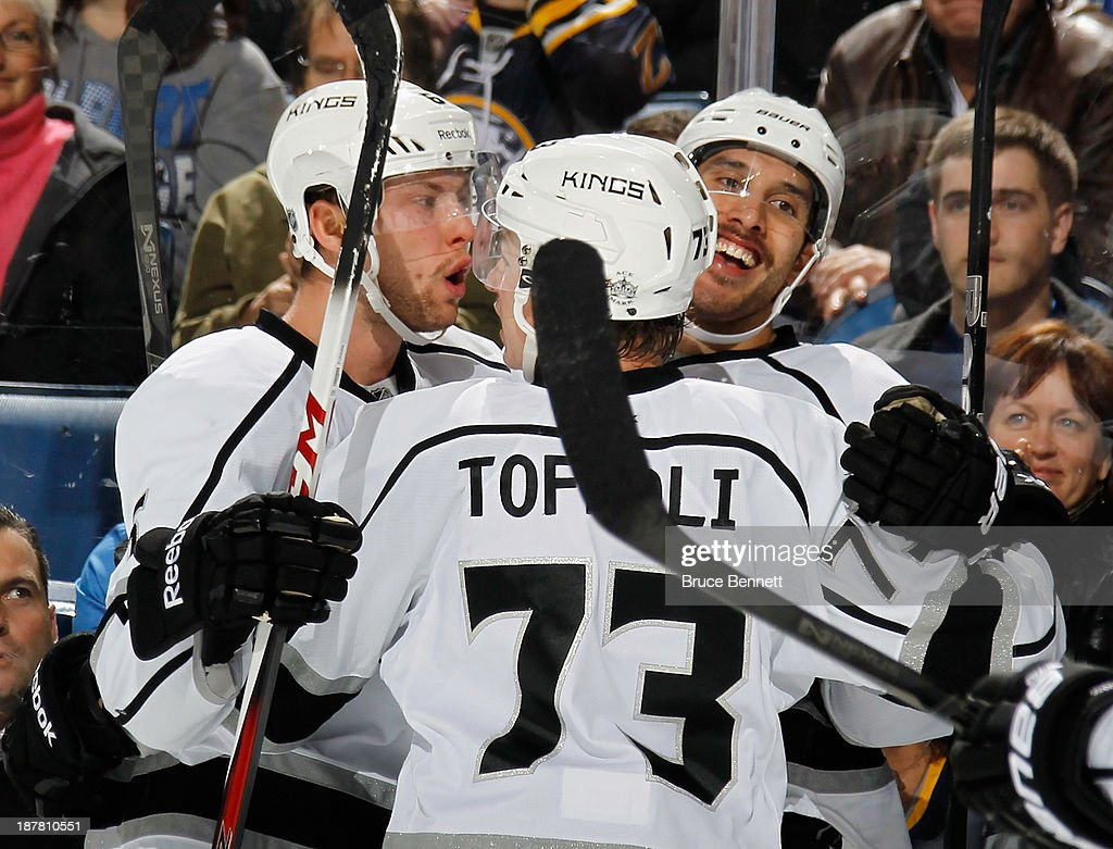 Dwight King #74 (R) of the Los Angeles Kings celebrates his goal at 16:26 of the third period against the Buffalo Sabres at the First Niagara Center on November 12, 2013 in Buffalo, New York. Joining him are Jake Muzzin #6 (L) and Tyler Toffoli #73 (C).The Sabres defeated the Kings 3-2 in the shootout.