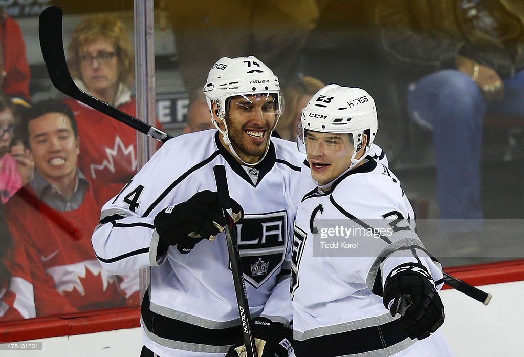 <a gi-track='captionPersonalityLinkClicked' href=/galleries/search?phrase=Dwight+King&family=editorial&specificpeople=4537297 ng-click='$event.stopPropagation()'>Dwight King</a> (L) of the Los Angeles Kings celebrates his goal with teammate Dustin Brown during the third period of their NHL hockey game against the Calgary Flames at the Scotiabank Saddledome February 27, 2014 in Calgary, Alberta, Canada.