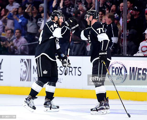 Dwight King of the Los Angeles Kings celebrates his goal with Jeff Carter to take a 31 lead over the Montreal Canadiens during the third period at...
