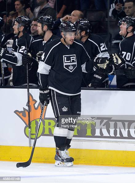 Dwight King of the Los Angeles Kings celebrates his goal with the bench to take a 10 lead over the New York Islanders during the first period at...