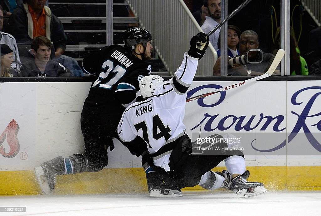 <a gi-track='captionPersonalityLinkClicked' href=/galleries/search?phrase=Dwight+King&family=editorial&specificpeople=4537297 ng-click='$event.stopPropagation()'>Dwight King</a> #74 of the Los Angeles Kings collides up against the boards with <a gi-track='captionPersonalityLinkClicked' href=/galleries/search?phrase=Scott+Hannan&family=editorial&specificpeople=203195 ng-click='$event.stopPropagation()'>Scott Hannan</a> #27 of the San Jose Sharks in the second period in Game Four of the Western Conference Semifinals during the 2013 NHL Stanley Cup Playoffs at HP Pavilion on May 21, 2013 in San Jose, California. The Sharks defeated the Kings 2-1.