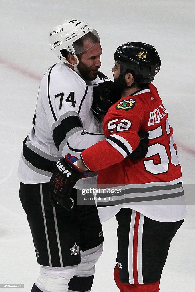 Dwight King #74 of the Los Angeles Kings fights with Brandon Bollig #52 of the Chicago Blackhawks during Game Seven of the Western Conference Final in the 2014 Stanley Cup Playoffs at United Center on June 1, 2014 in Chicago, Illinois.