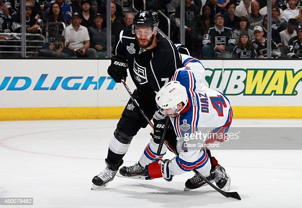 Dwight King of the Los Angeles Kings gets tangled with Raphael Diaz of the New York Rangers during the third period of Game One of the 2014 Stanley...