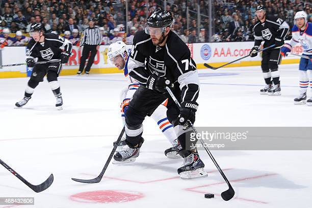 Dwight King of the Los Angeles Kings handles the puck against Justin Schultz of the Edmonton Oilers at STAPLES Center on April 02 2015 in Los Angeles...