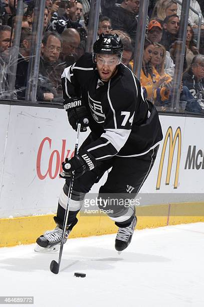 Dwight King of the Los Angeles Kings handles the puck during a game against the Ottawa Senators at STAPLES Center on February 26 2015 in Los Angeles...