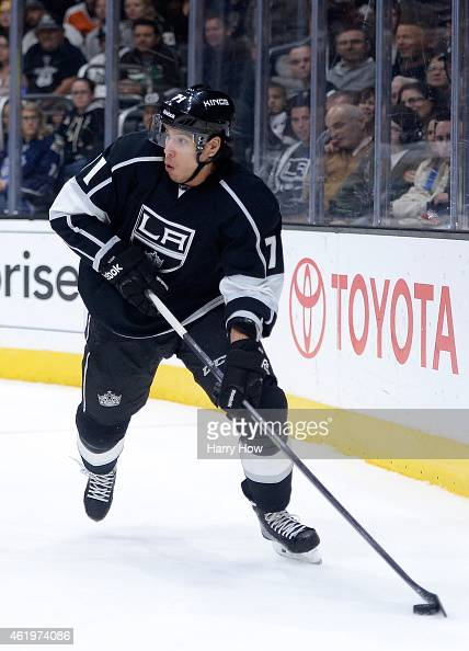 Dwight King of the Los Angeles Kings looks to pass from behind the net during the game against the Calgary Flames at Staples Center on January 19...