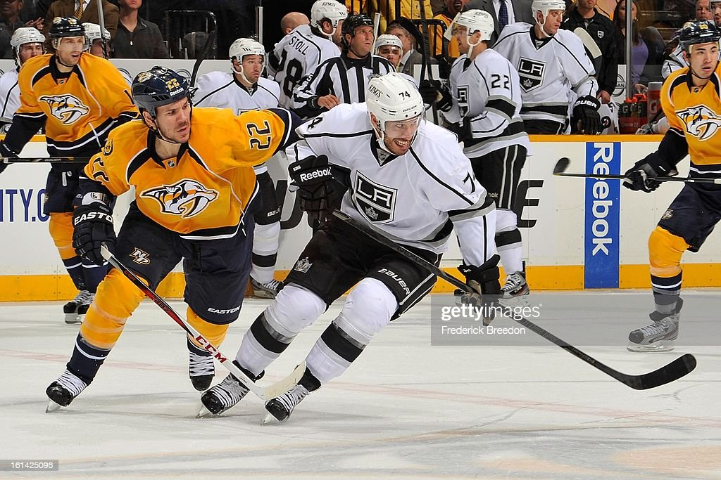 <a gi-track='captionPersonalityLinkClicked' href=/galleries/search?phrase=Dwight+King&family=editorial&specificpeople=4537297 ng-click='$event.stopPropagation()'>Dwight King</a> #74 of the Los Angeles Kings plays against <a gi-track='captionPersonalityLinkClicked' href=/galleries/search?phrase=Scott+Hannan&family=editorial&specificpeople=203195 ng-click='$event.stopPropagation()'>Scott Hannan</a> #22 of the Nashville Predators at the Bridgestone Arena on February 7, 2013 in Nashville, Tennessee.