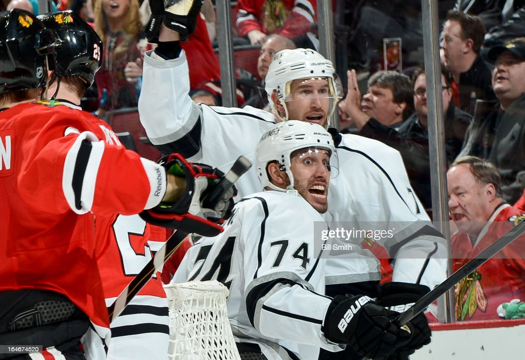 <a gi-track='captionPersonalityLinkClicked' href=/galleries/search?phrase=Dwight+King&family=editorial&specificpeople=4537297 ng-click='$event.stopPropagation()'>Dwight King</a> #74 of the Los Angeles Kings reacts after scoring against the Chicago Blackhawks as his teammate <a gi-track='captionPersonalityLinkClicked' href=/galleries/search?phrase=Jeff+Carter&family=editorial&specificpeople=227320 ng-click='$event.stopPropagation()'>Jeff Carter</a> #77 celebrates behind during the NHL game on March 25, 2013 at the United Center in Chicago, Illinois.