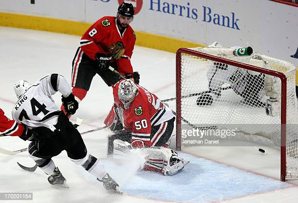 Dwight King of the Los Angeles Kings scores a goal in the second period against goalie Corey Crawford of the Chicago Blackhawks during Game Five of...