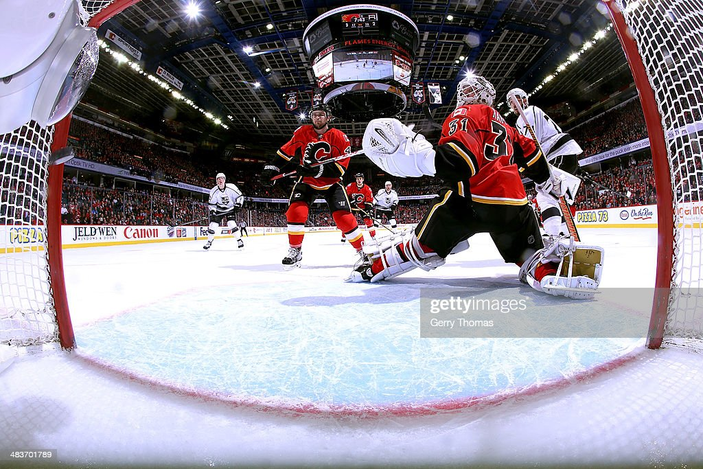 <a gi-track='captionPersonalityLinkClicked' href=/galleries/search?phrase=Dwight+King+-+Ice+Hockey+Player&family=editorial&specificpeople=4537297 ng-click='$event.stopPropagation()'>Dwight King</a> #74 of the Los Angeles Kings scores against <a gi-track='captionPersonalityLinkClicked' href=/galleries/search?phrase=Karri+Ramo&family=editorial&specificpeople=716721 ng-click='$event.stopPropagation()'>Karri Ramo</a> #31 of the Calgary Flames at Scotiabank Saddledome on April 9, 2014 in Calgary, Alberta, Canada.