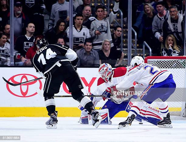 Dwight King of the Los Angeles Kings scores on a breakaway past Ben Scrivens and Alex Galchenyuk of the Montreal Canadiens to take a 31 lead during...