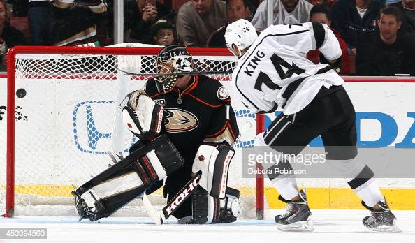 Dwight King of the Los Angeles Kings scores the winning goal against Jonas Hiller of the Anaheim Ducks in an overtime shootout on December 3 2013 at...