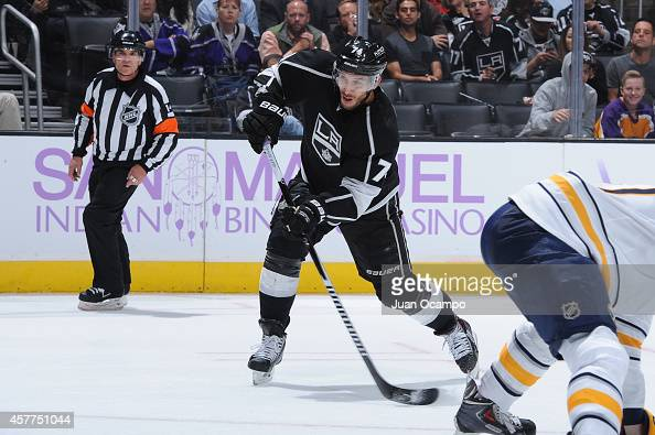 Dwight King of the Los Angeles Kings shoots during a game against the Buffalo Sabres at STAPLES Center on October 23 2014 in Los Angeles California