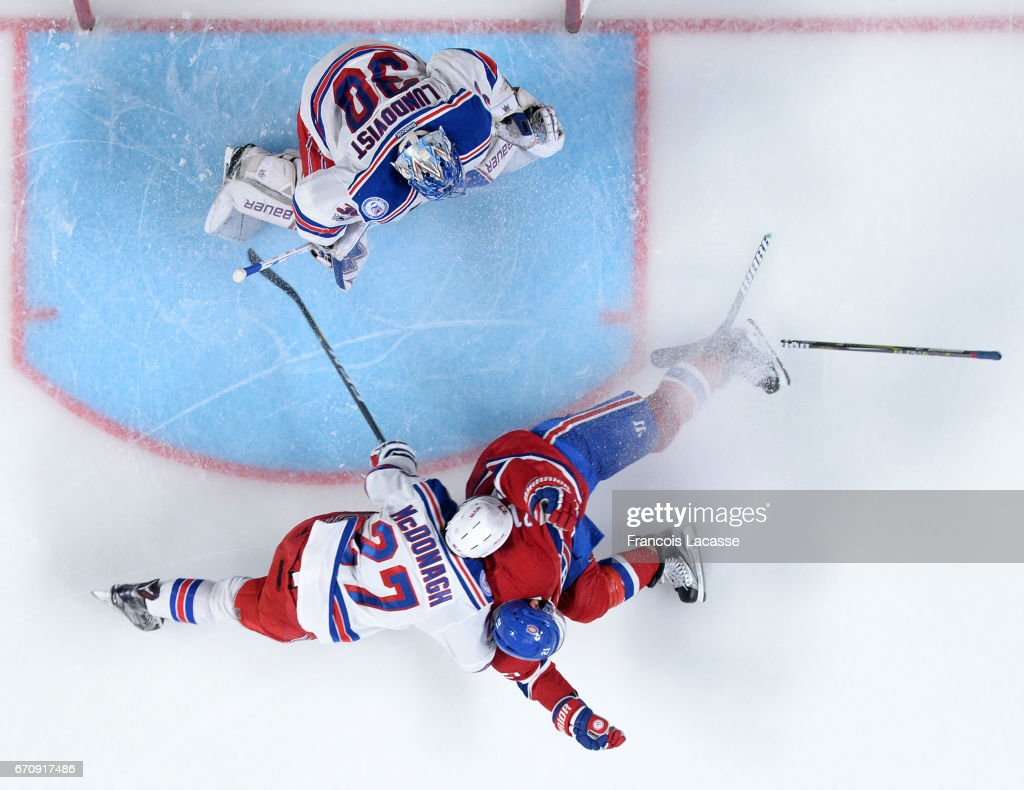 Dwight King #21 of the Montreal Canadiens collides with Ryan McDonagh #27 of the New York Rangers in Game Five of the Eastern Conference Quarterfinals during the 2017 NHL Stanley Cup Playoffs at the Bell Centre on April 20, 2017 in Montreal, Quebec, Canada.