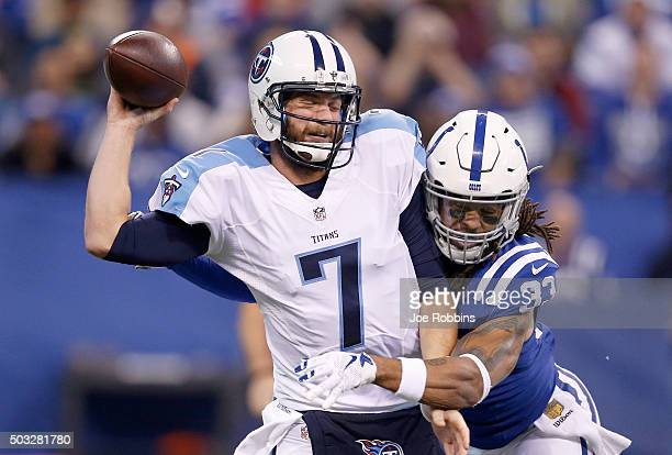 Dwight Lowery of the Indianapolis Colts hits Zach Mettenberger of the Tennessee Titans at Lucas Oil Stadium on January 3 2016 in Indianapolis Indiana