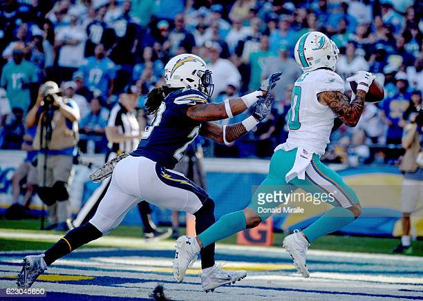 Dwight Lowery of the San Diego Chargers can't reach Kenny Stills of the Miami Dolphins as Stills scores against the San Diego Chargers during the...