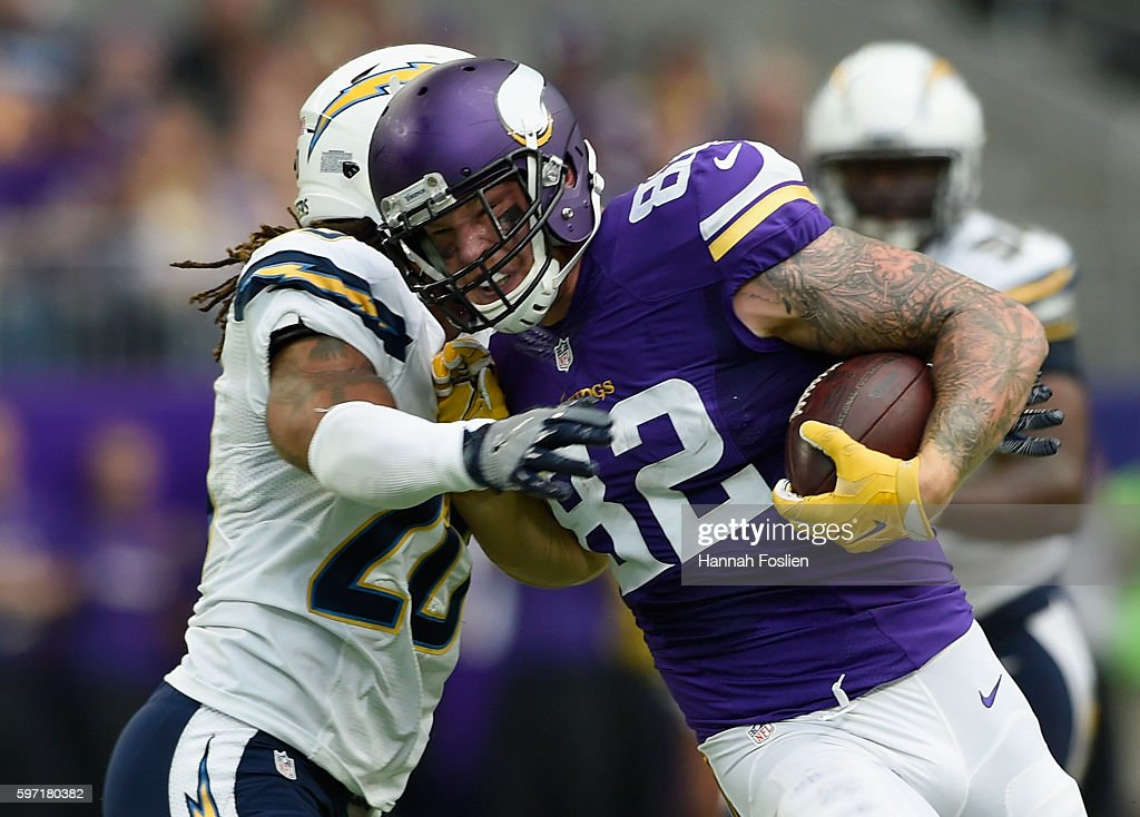 Dwight Lowery of the San Diego Chargers tackles Kyle Rudolph of the Minnesota Vikings during the second quarter of the game on August 28 2016 at US...