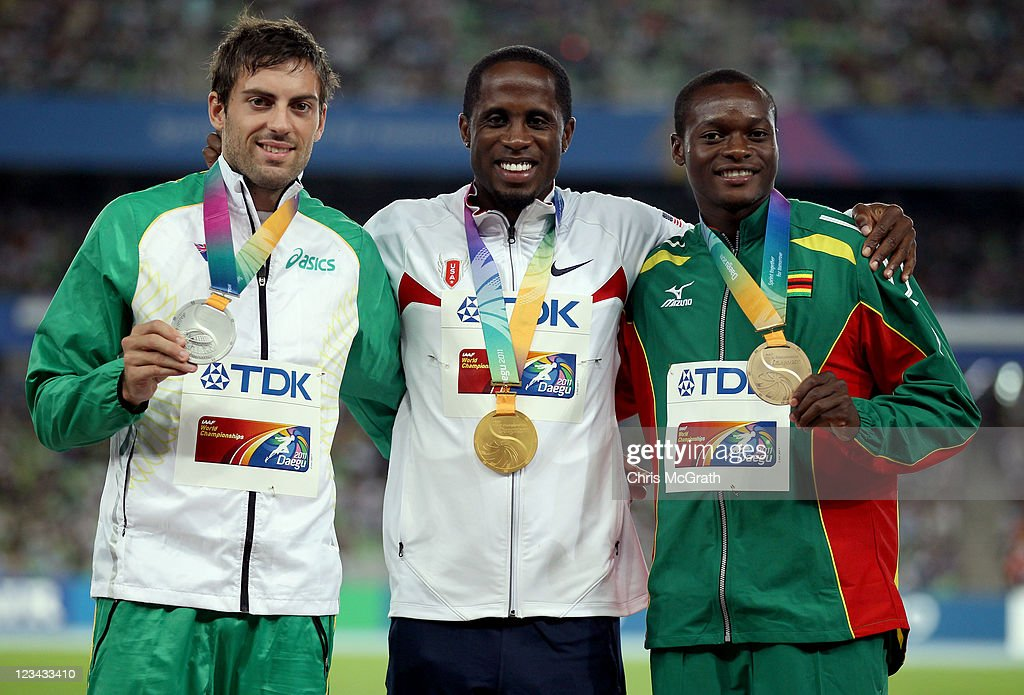 Dwight Phillips of the USA poses with his gold medal, Mitchell Watt of Australia the silver and Ngonidzashe Makusha of Zimbabwe the bronze during the medal ceremony for the men's long jump during day eight of 13th IAAF World Athletics Championships at Daegu Stadium on September 3, 2011 in Daegu, South Korea.