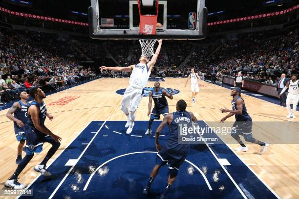 Dwight Powell of the Dallas Mavericks drives to the basket against the Minnesota Timberwolves on December 10 2017 at Target Center in Minneapolis...