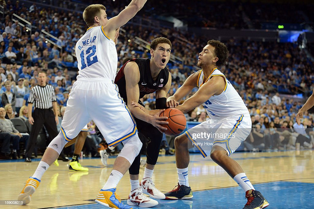 Dwight Powell #33 of the Stanford Cardinal attempts a shot between David Wear #12 and Kyle Anderson #5 of the UCLA Bruins at Pauley Pavilion on January 5, 2013 in Los Angeles, California.