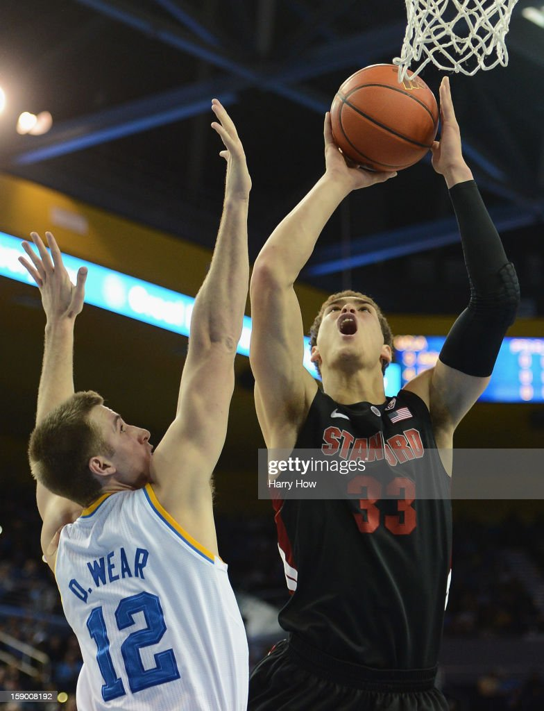 Dwight Powell #33 of the Stanford Cardinal attempts a shot in front of David Wear #12 of the UCLA Bruins at Pauley Pavilion on January 5, 2013 in Los Angeles, California.