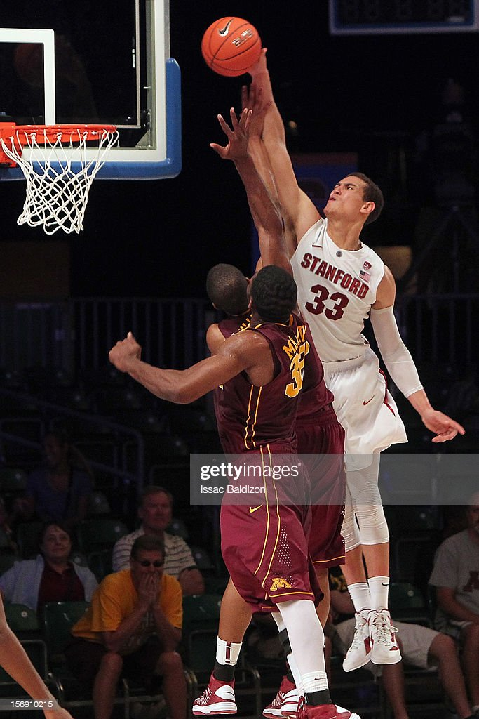 Dwight Powell #33 of the Stanford Cardinal dunks over Rodney Williams #33 of the Minnesota Gophers during the Battle 4 Atlantis tournament at Atlantis Resort November 24, 2012 in Nassau, Paradise Island, Bahamas.