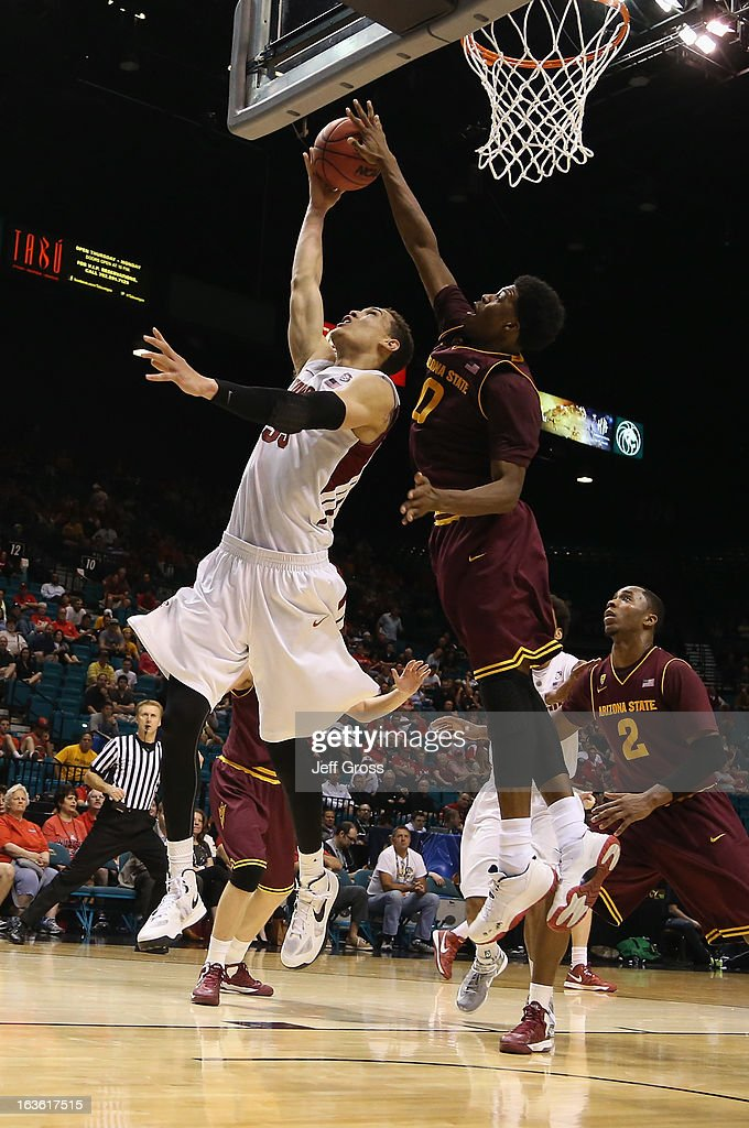 Dwight Powell #33 of the Stanford Cardinal is blocked by Carrick Felix #0 of the Arizona State Sun Devils in the second half during the first round of the Pac 12 Tournament at the MGM Grand Garden Arena on March 13, 2013 in Las Vegas, Nevada. Arizona State defeated Stanford 89-88 in overtime.