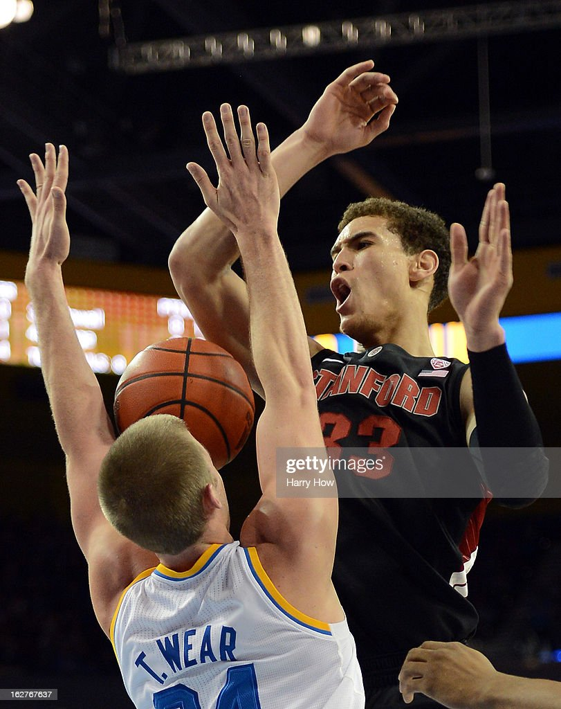 Dwight Powell #33 of the Stanford Cardinal loses the ball in front of Travis Wear #24 of the UCLA Bruins at Pauley Pavilion on January 5, 2013 in Los Angeles, California.