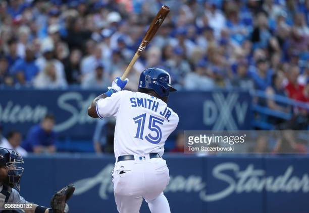 Dwight Smith Jr #15 of the Toronto Blue Jays bats in the second inning during MLB game action against the Tampa Bay Rays at Rogers Centre on June 14...