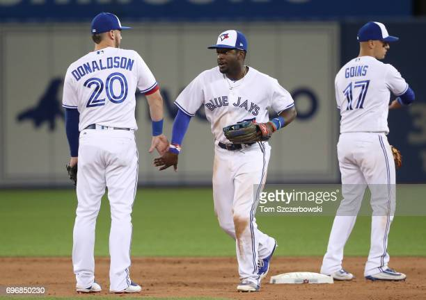 Dwight Smith Jr #15 of the Toronto Blue Jays celebrates their victory with Josh Donaldson during MLB game action against the Tampa Bay Rays at Rogers...