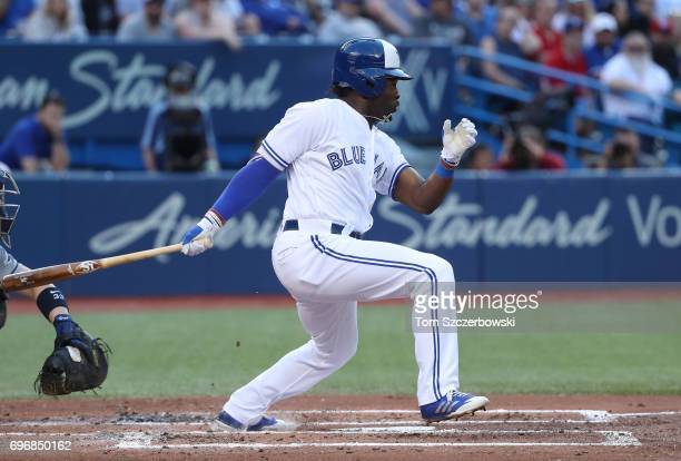 Dwight Smith Jr #15 of the Toronto Blue Jays hits a single in the second inning during MLB game action against the Tampa Bay Rays at Rogers Centre on...