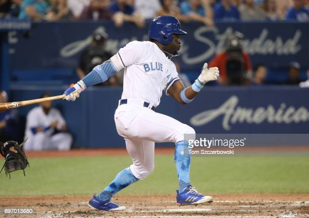Dwight Smith Jr #15 of the Toronto Blue Jays hits an RBI single in the seventh inning during MLB game action against the Chicago White Sox at Rogers...