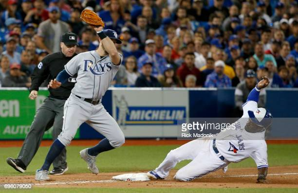 Dwight Smith Jr slides into 3rd as Tampa Bay Rays third baseman Evan Longoria is late with an attempted tag Toronto Blue Jays Vs Tampa Bay Rays in...