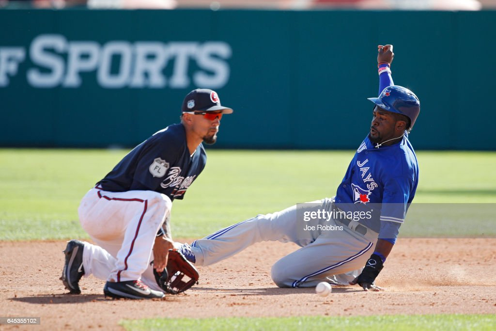 Dwight Smith #65 of the Toronto Blue Jays steals second base in the fourth inning during the spring training game at Champion Stadium on February 25, 2017 in Lake Buena Vista, Florida. The Braves defeated the Blue Jays 7-4.