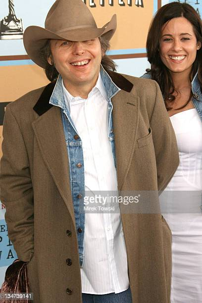 Dwight Yoakam and guest during Film Independent's 2006 Independent Spirit Awards Arrivals at Santa Monica Beach in Santa Monica California United...