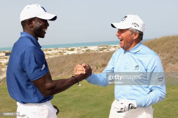 Dwight Yorke and Academy Member Gary Player shake hands during the Laureus Golf Challenge at the Saadiyat Beach Golf Club part of the 2011 Laureus...