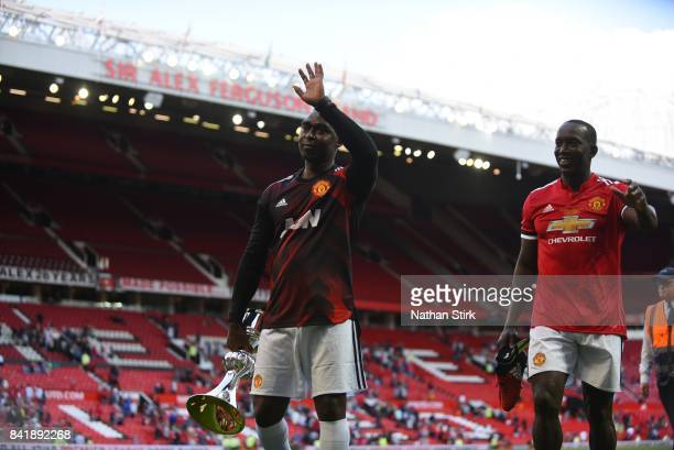 Dwight Yorke and Andrew Cole of Manchester United walk of the pitch during the match between Manchester United Legends and FC Barcelona Legends at...