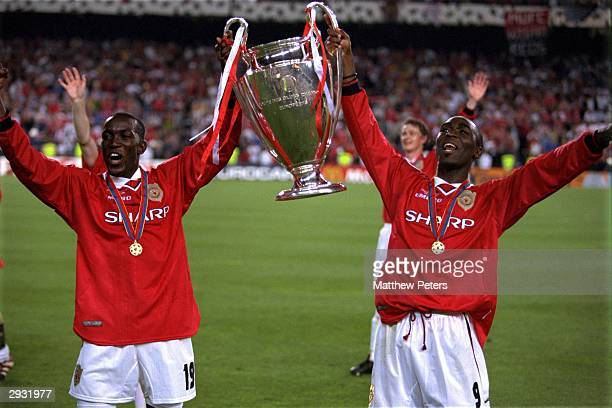 Dwight Yorke and Andy Cole of Manchester United lift the European Cup after the UEFA Champions League Final between Bayern Munich v Manchester United...