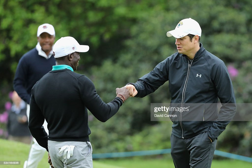 Dwight Yorke and <a gi-track='captionPersonalityLinkClicked' href=/galleries/search?phrase=Vernon+Kay&family=editorial&specificpeople=211386 ng-click='$event.stopPropagation()'>Vernon Kay</a> celebrate during the Pro-Am prior to the BMW PGA Championship at Wentworth on May 25, 2016 in Virginia Water, England.