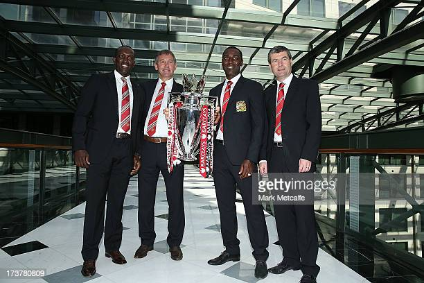 Dwight Yorke Bryan Robson Andy Cole and Dennis Irwin pose with the Barclays Premier League trophy during the official Manchester United official...