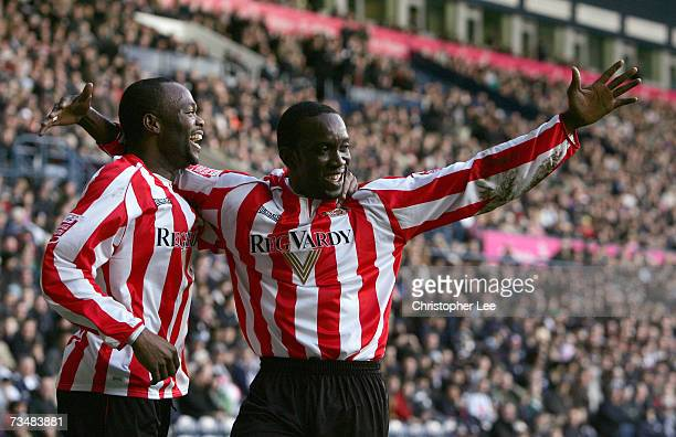 Dwight Yorke of Sunderland celebrates scoring their first goal with Stern John during the CocaCola Championship match between West Bromwich Albion...