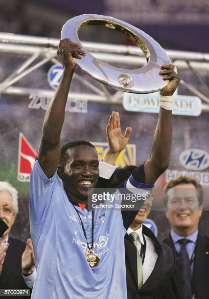 Dwight Yorke of Sydney FC holds the trophy aloft after winning the Hyundai ALeague Grand Final between Sydney FC and the Central Coast Mariners at...