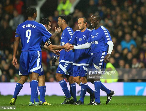 Dwight Yorke of the Rest of the World celebrates with teammates after scoring a goal during the David Beckham Match for Children in aid of UNICEF...