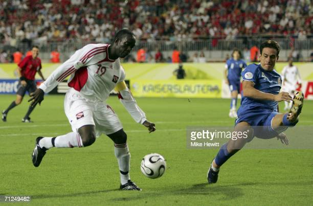 Dwight Yorke of Trinidad and Tobago attempts a shot on goal as Carlos Gamarra of Paraguay closes in during the FIFA World Cup Germany 2006 Group B...