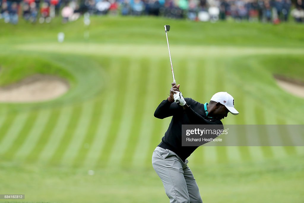 Dwight Yorke tees off during the Pro-Am prior to the BMW PGA Championship at Wentworth on May 25, 2016 in Virginia Water, England.