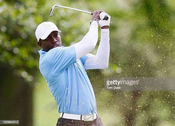 Dwight Yorke tees off on the 4th hole during the Andrew Cole Golf Day raising vital funds for youth charity The Prince's Trust at The Grove Golf Club...