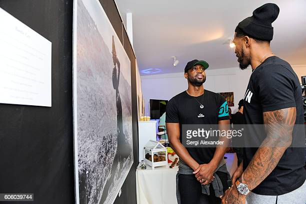 Dwyane Wade and Bob Metelus attend Haitian photographer Bob Metelus unveils newest collection Haiti A Collective Cry from a Forgotten Paradise on...